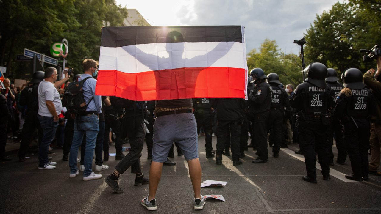 A man sporting a Reich flag at a demonstration against the German government's health measures against the coronavirus in Berlin.