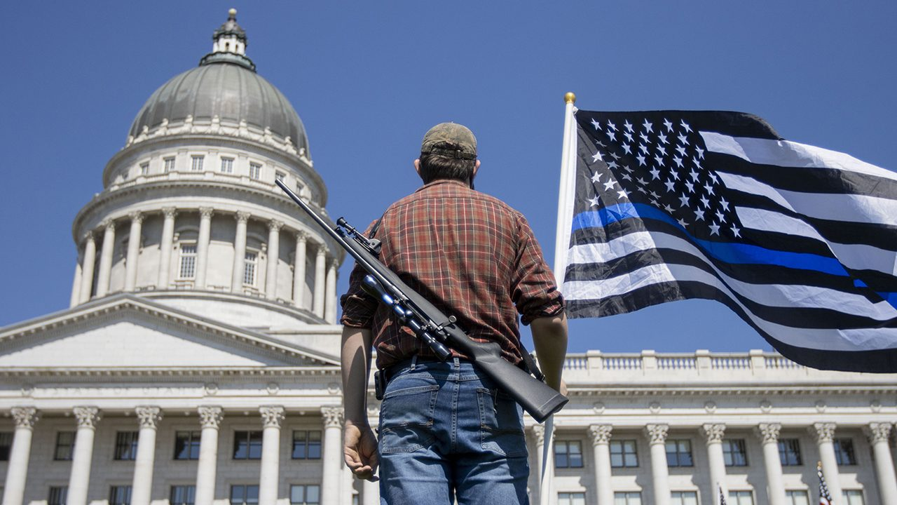 Standing by: an armed Trump supporter in Utah.