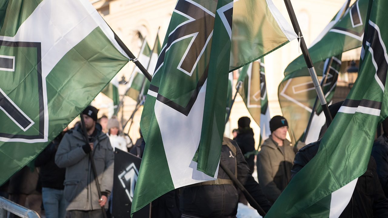 Green and white: the colours of the Nordic Resistance Movment, here at a demonstration in Stockholm