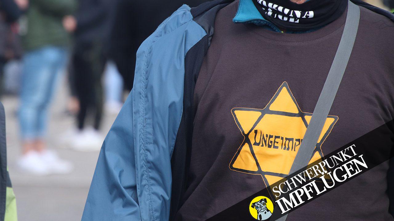 """Die """"neuen Juden"""": Teilnehmer einer """"Hygiene-Demo"""" in Berlin trägt einen gelben """"Judenstern"""""""