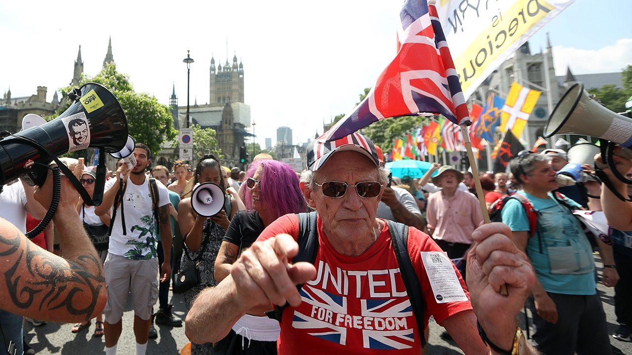 Protest trotz Freiheit: Brit:innen demonstrieren am Freedom Day gegen den Lockdown in London.
